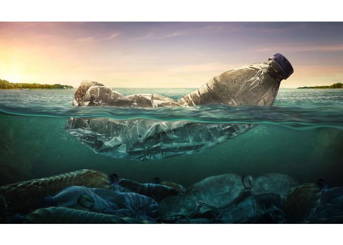 Plastic water bottle floating in the ocean